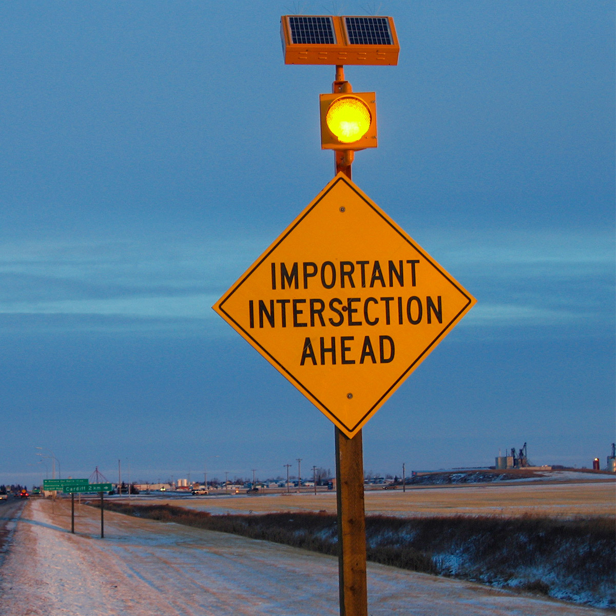 solar-powered warning sign beacon on important intersection ahead sign