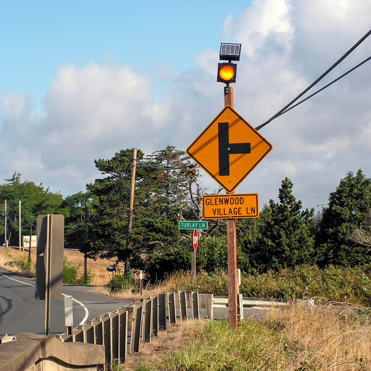 solar-powered warning sign flashing beacon on sign