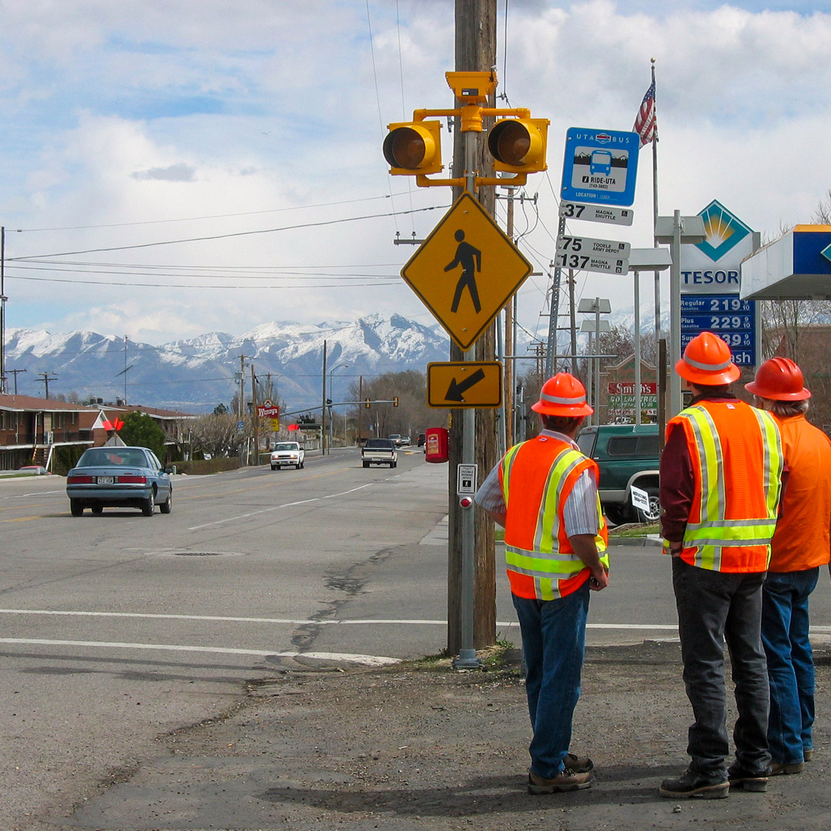 solar-powered crosswalk beacon with installers