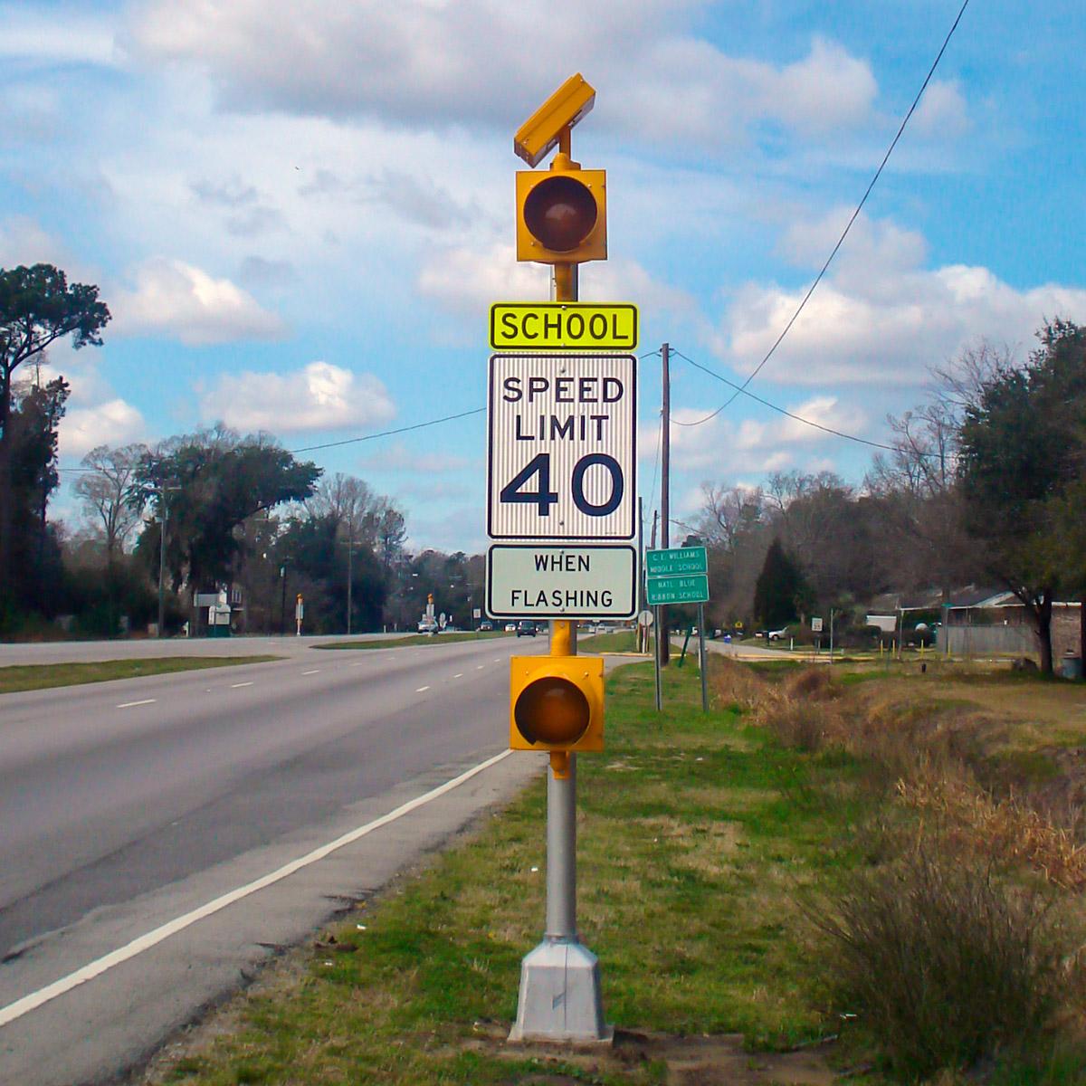 carmanah solar-powered school zone speed sign beacon on round pole in south carolina