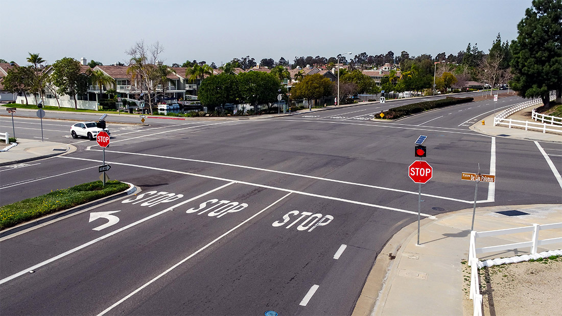 Four-way stop intersection in Yorba Linda, California, controlled by solar-powered stop sign flashing beacons