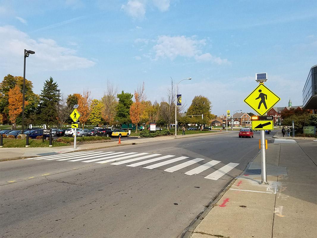 Midblock crosswalk in Buffalo, New York equipped with solar-powered rectangular rapid flashing beacons