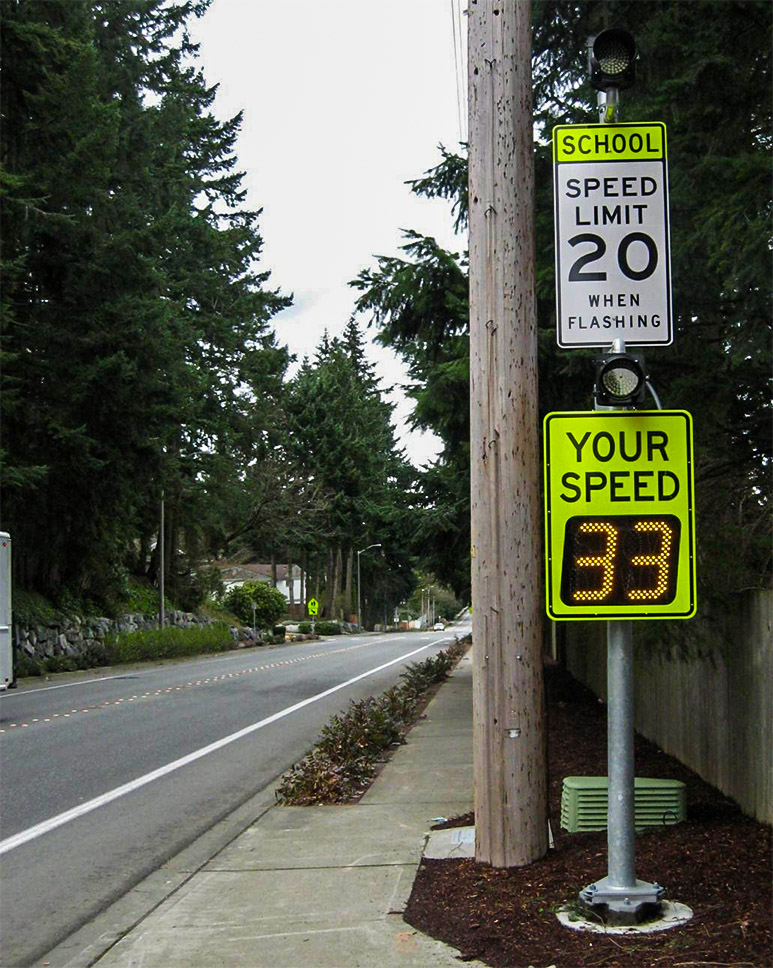 speedcheck radar speed sign flashing 33 in school zone in redmond, wa