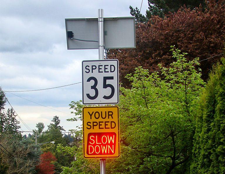speedcheck speed radar sign flashing slow down message in cedar mills, oregon