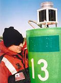 FN Greg Panas holding with Model 701 on buoy