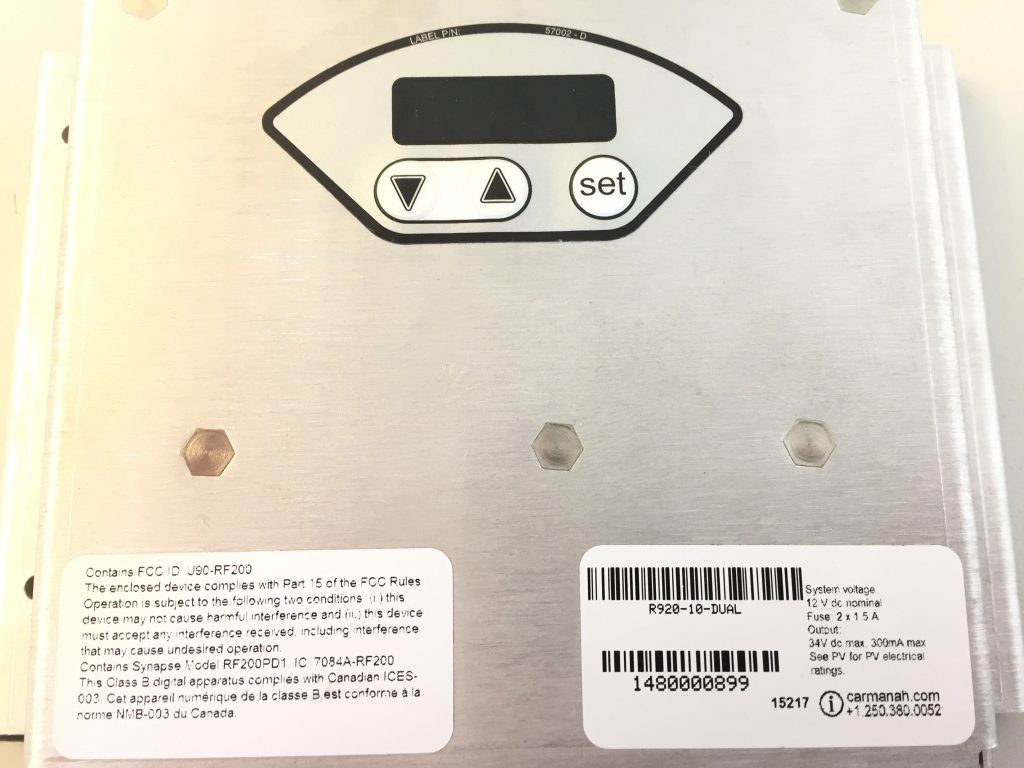 The R920 system serial number can be located on the front side of the energy management system plate.