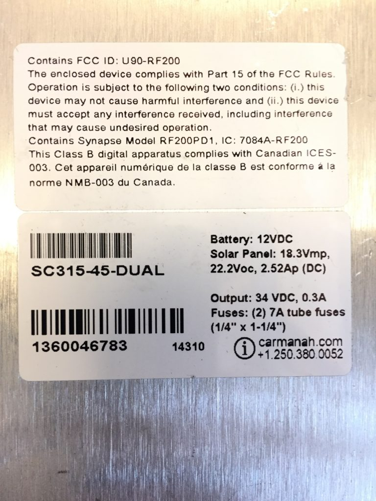 The SC315 system serial number may be located inside the cabinet.
