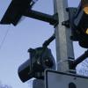 Detail of an R820 Solar LED Pedestrian Beacon on a light pole.