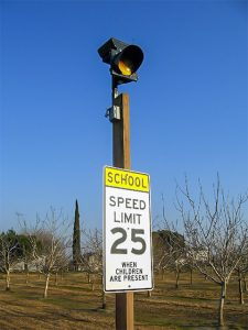 carmanah school zone speed sign beacon on wood post
