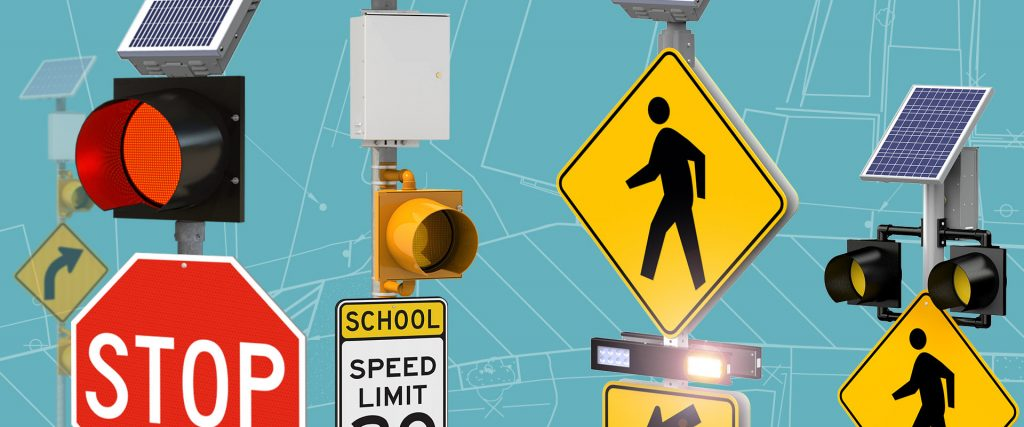 Selection of traffic flashing lights above stop signs, school speed limit signs and crosswalks.