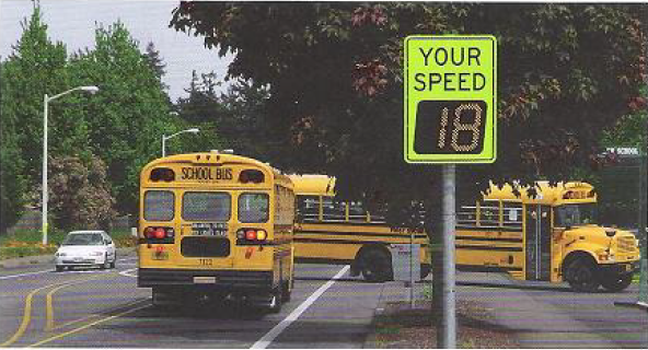 School buses and Your Speed digital sign. Image from the Public Risk Magazine