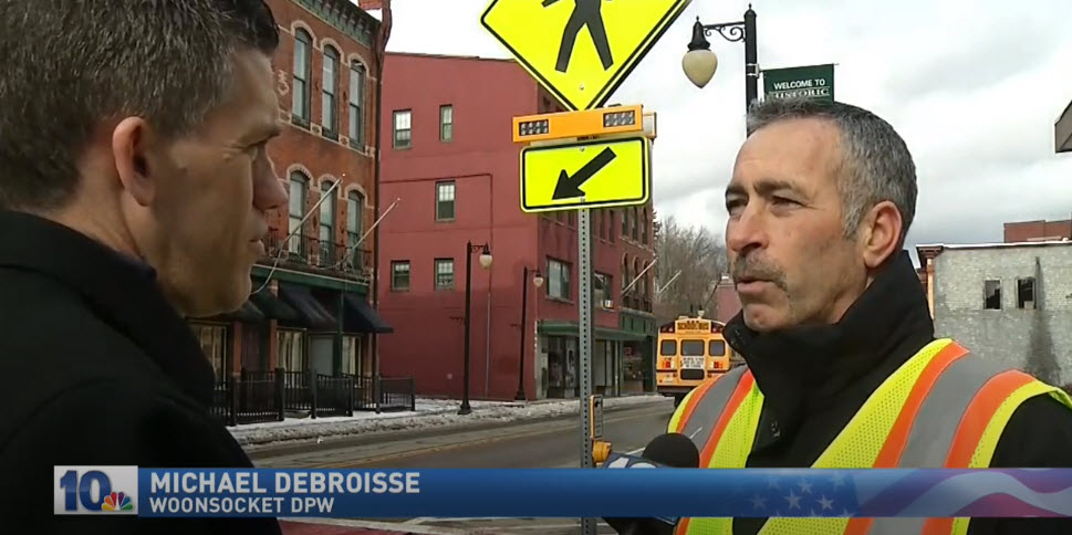 NBC 10 screengrab showing Carmanah RRFB at crosswalk in Woonsocket, Rhode Island, while Mike Debroisse speaks about it
