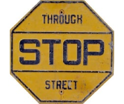 yellow stop sign circa 1950s
