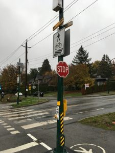 RRFB mounted on a crosswalk and stop sign in Vancouver