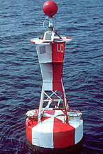 "A classic picture of a<br /> lighted buoy outfitted with a red daymark atop its tower"" border=""0″ /></td> </tr> <tr> <td align="